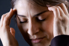 Woman with headache. Close up of a woman with a headache Royalty Free Stock Image
