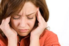 Woman with headache. Portrait of a woman with severe headache Stock Photos