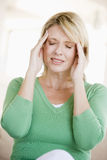 Woman With A Headache Stock Image