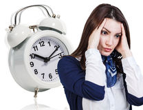 Woman with a headache and alarm clock Stock Photo