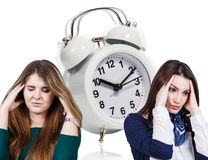 Woman with a headache and alarm clock royalty free stock photos