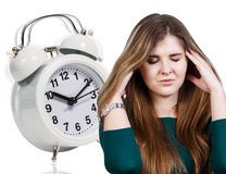 Woman with a headache and alarm clock Royalty Free Stock Images