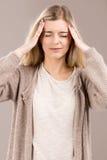 Woman with headache Stock Photo