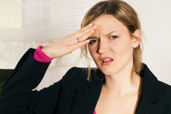 Woman with headache and fever Stock Photos