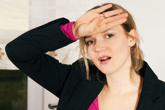 Woman with headache and fever Stock Images
