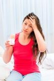 Woman with a headache Stock Photos