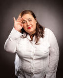 Woman with headache. Holding head Stock Photography