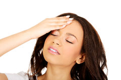 Woman with a headache holding head. Royalty Free Stock Photos