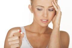 Woman with headache Stock Image