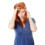 Woman with headache holding her hand to the head Royalty Free Stock Photo
