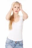 Woman with headache holding her hand to the head Royalty Free Stock Photos