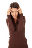 Woman with headache holding her hand to the head. Royalty Free Stock Photos