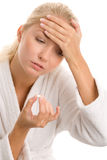 Woman with headache taking pill Royalty Free Stock Photos