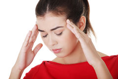 Woman with a headache holding temples Royalty Free Stock Image
