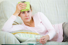 Woman with headache at home Stock Images