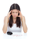 Woman with headache look on pills medicine tablets Royalty Free Stock Photography