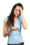 Woman with headache looking at pill Stock Photography