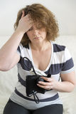 Woman with headache measures a  blood pressure Royalty Free Stock Photo