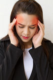 Woman with headache and negative expression Stock Photography