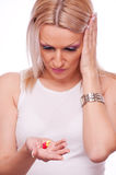 Woman with headache pills Stock Photography