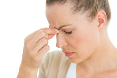 Woman with headache pinching her nose Stock Photography
