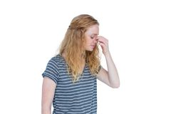 Woman with headache pinching her nose. On white background Stock Photography