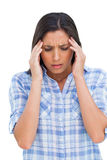 Woman with a headache rubbing her temples Stock Photography