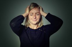 Woman with a headache. Stock Image
