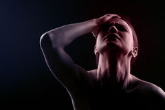 Woman with a headache Royalty Free Stock Photos