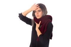 Woman with headache and sore throat. Young woman in black shirt with vinous scarf having a headache and sore throat on white background in studio Stock Photos
