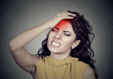 Woman with headache, stress, insomnia, hangover with red alert accent. Portrait of a woman with headache, stress, insomnia, hangover with red alert accent Stock Photo