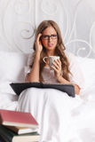 Woman with headache studying Royalty Free Stock Photo