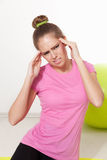 Woman with headache during workout Royalty Free Stock Image
