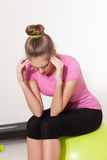 Woman with headache during workout Stock Images