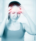 Woman with a headache Royalty Free Stock Photography