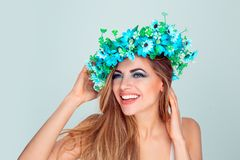 Woman with headband from blue flowers touching chin and hair flirting royalty free stock photo