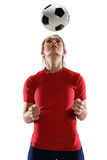 Woman Heading Soccer Ball. Isolated over white background stock image