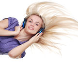 Woman with headpfones Royalty Free Stock Image