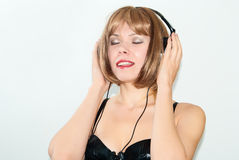 Woman and headphone. Portrait of woman with headphone listening music Royalty Free Stock Photos