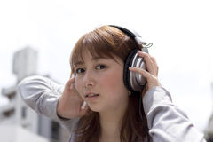 Woman in headphone Stock Photos