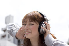 Woman in headphone Royalty Free Stock Image