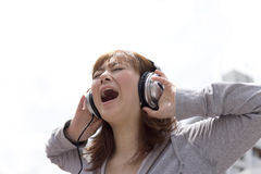 Woman in headphone Royalty Free Stock Photography
