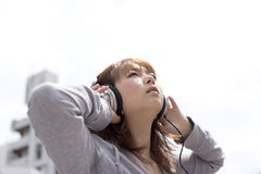 Woman in headphone Stock Image
