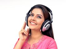 Woman with a headphone. Asian woman with a headphone, listening to music Royalty Free Stock Photography