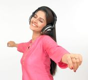 Woman with a headphone. Asian woman with a headphone, listening to music Stock Image
