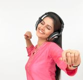 Woman with a headphone. Listening to music Royalty Free Stock Photo