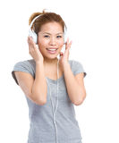 Woman with headphone listening music Stock Images
