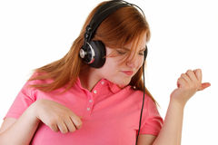 Woman with headphone playing air guitar Stock Images