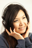 Woman and headphone Stock Image