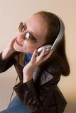 Woman with headphones-04. A young woman listens to music on headphones Royalty Free Stock Photography